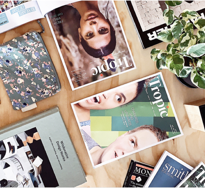 Flat lay of Tropic Magazine with plant